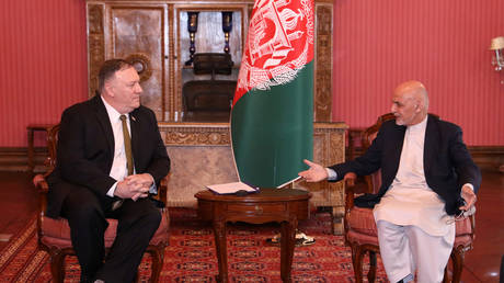 Afghanistan's President Ashraf Ghani (R) meets with US Secretary of State Mike Pompeo in Kabul, Afghanistan, March 23, 2020.