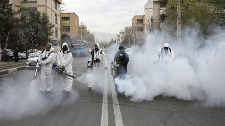 FILE PHOTO. Emergency workers are seen disinfecting streets of Tehran, Iran.