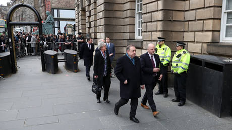 Alex Salmond leaves the High Court in Edinburgh after he was cleared of attempted rape and a series of sexual assaults
