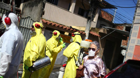 Cleaners disinfect streets in Brazil during the coronavirus pandemic © REUTERS/Pilar Olivares