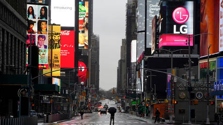 Person takes pictures in the middle of 7th Avenue in Manhattan