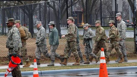 US military personnel walk outside of coronavirus testing center in Staten Island borough of New York City