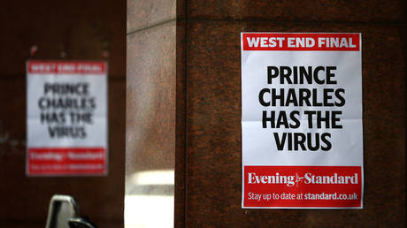 """Posters reading """"Prince Charles has the virus"""" are seen in London, Britain, March 26, 2020."""
