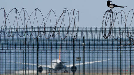 A fence surrounding Beijing Capital International Airport, China, March 13, 2020.