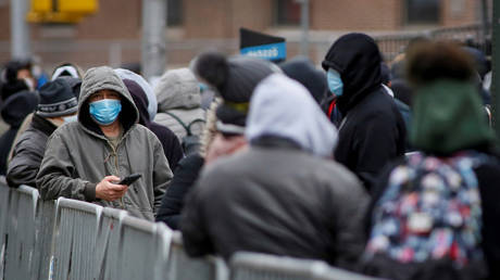 FILE PHOTO: People wait in line to be tested for Covid-19 while wearing protective gear, outside Elmhurst Hospital Center in  New York City, the US' major coronavirus epicenter.
