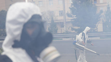 Firefighters disinfect streets in Tehran, Iran March 18, 2020.