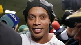 Ronaldinho ARRESTED as judge rejects prosecutor's recommendation to release Brazilian superstar over fake passport claims