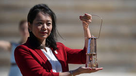 Tokyo 2020 Games organizers receive Olympic flame in scaled-down ceremony in Athens