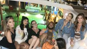 Social distancing? Grinning NFL star Derrius Guice takes flak after cozying up to six models on Miami boat