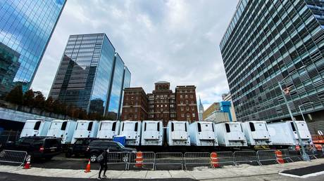A row of refrigeration units used as makeshift morgues in New York City, March 31, 2020