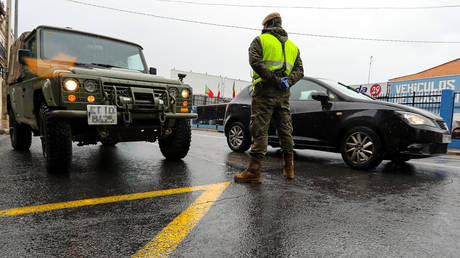 Car registration plate in this image has been pixellated) A military is seen at a checkpoint to control weekend traffic during the state of alarm and the accomplishment of confinement measures due to coronavirus outbreak on March 27, 2020 in Valencia, Spain