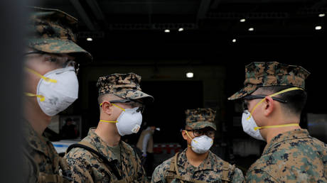 Military personnel wearing protective face masks in New York City