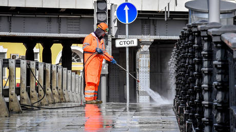 A municipal worker spraying disinfectant in central Moscow, on April 5, 2020