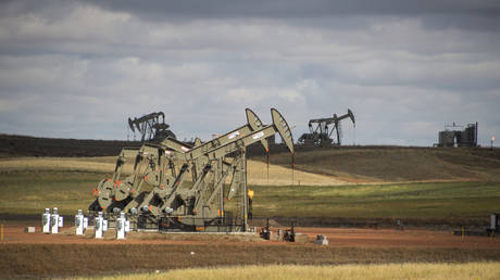 Pump jacks are seen on the Bakken Shale Formation, near Williston, North Dakota, US