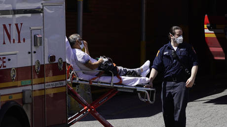 FILE PHOTO: A patient is wheeled into an emergency arrival area at Elmhurst Hospital in New York City, New York, US, on April 6, 2020.