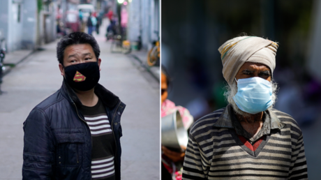 Men in China and India wear face masks to protect themselves from the coronavirus © Reuters / Aly Song and Adnan Abidi