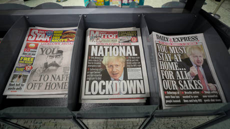 FILE PAPER: Newspapers displayed at a local shop in Malvern, the day after Prime Minister Boris Johnson put the UK in lockdown to help curb the spread of the coronavirus