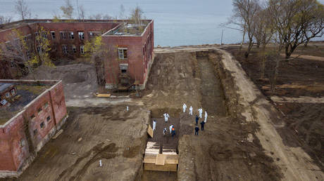 Bodies being buried on Hart Island amid the Covid-19 outbreak in New York City, April 9, 2020.