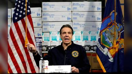 New York Governor Andrew Cuomo speaks in front of stacks of medical protective supplies during a news conference at the Jacob K. Javits Convention Center in New York City, New York, U.S., March 24, 2020. © REUTERS/Mike Segar