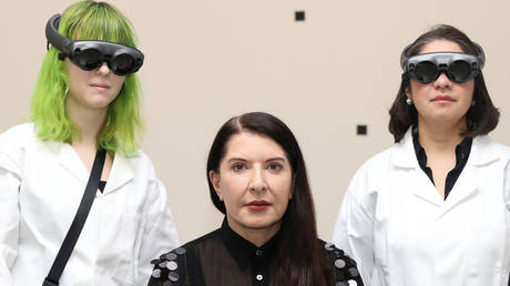 Abramovic with two audience members enjoying her latest exhibition © Reuters / Simon Dawson
