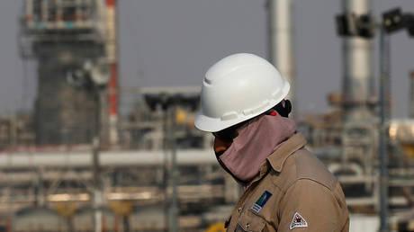 An employee looks on at Saudi Aramco oil facility in Abqaiq, Saudi Arabia