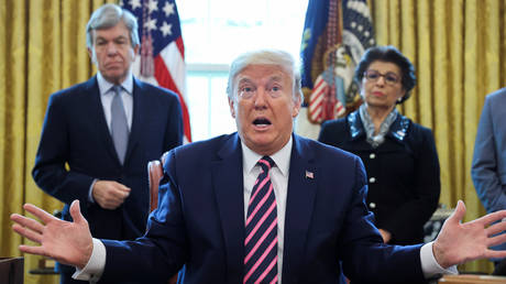Donald Trump participates in coronavirus relief bill signing ceremony at the White House in Washington
