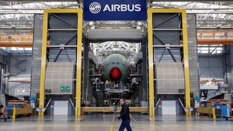 An employee walks in front of the final assembly line at Airbus headquarters in Blagnac near Toulouse, France.