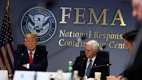 FILE PHOTO: US President Donald Trump and Vice President Mike Pence attend a teleconference with governors at FEMA's headquarters, in Washington, DC.