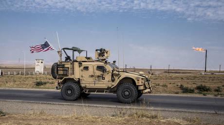 Oct. 28, 2019 file photo, U.S. forces patrol Syrian oil fields, in eastern Syria. © AP Photo/Baderkhan Ahmad