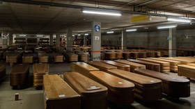 Spanish parking lot converted into huge makeshift morgue as Covid-19 deaths surge (VIDEO)