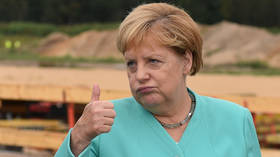 Angela Merkel ends self-isolation and returns to Chancellery after testing NEGATIVE for Covid-19