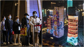 Making a comeback: Wuhan aglow as outbound travel ban lifted & residents flock to train stations (PHOTO, VIDEO)