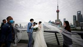 Wuhan couples BOMBARD marriage application app as coronavirus lockdown is lifted