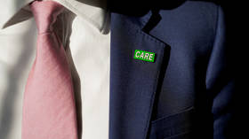 'Who cares?' UK Health Secretary unveils 'badge of honor' for social care workers, gets hit by FURIOUS criticism