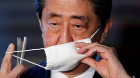 Japan's Abe tells G7 he backs WHO on coronavirus response, in contrast with Trump