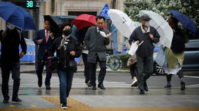 S. Koreans return to work and shops as govt eases social distancing rules