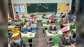 Thinking caps on: Chinese school kids return to classroom with the help of 'social distancing hats' (PHOTOS)