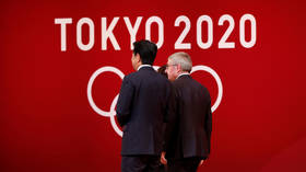 'Impossible' to hold Olympics unless pandemic is contained, Japan's PM Abe says
