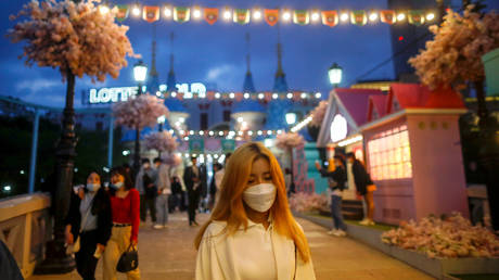 FILE PHOTO A woman wearing a mask in Seoul, South Korea. April 30, 2020. © Kim Hong-Ji / Reuters