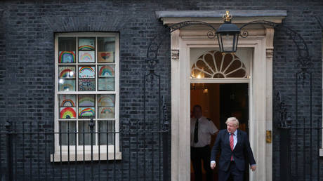 Britain's Prime Minister Boris Johnson is pictured outside 10 Downing Street on May 7, 2020.