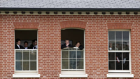 FILE PHOTO: Pupils watch during the visit by Britain's Prince Charles to open the new Bekynton Field Development building at Eton College near Windsor, Britain June 9, 2015