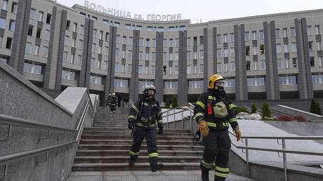 Firefighters outside a hospital in St. Petersburg, Russia.