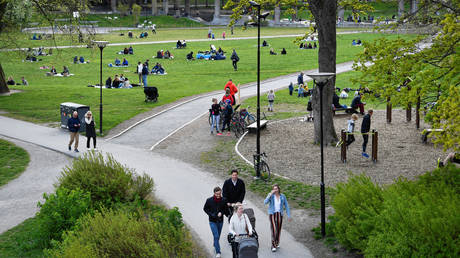 People enjoy a spring day at the Ralambshov park during the coronavirus disease (COVID-19) outbreak in Stockholm, Sweden