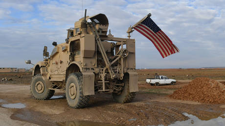 FILE PHOTO: US military patrol vehicle is parked on the road from Raqqa to Al-Hasakah, Syria