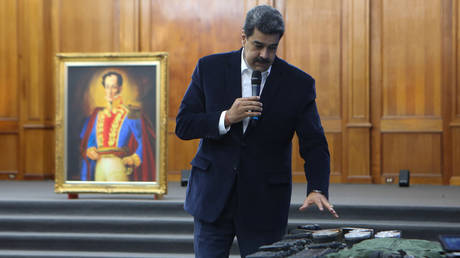 Venezuela's President Nicolas Maduro shows military equipment during a meeting with the armed forces © Miraflores Palace/Handout via REUTERS