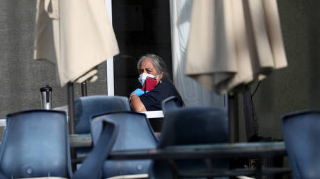 A woman on the patio of the Gateway Care and Rehabilitation Center in Hayward, California