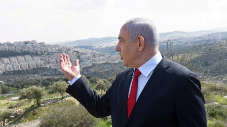 PM Benjamin Netanyahu, overlooking the Israeli settlement of Har Homa, located in an area of the Israeli-occupied West Bank that Israel annexed to Jerusalem after the region's capture in the Six-Day War of 1967, February 20, 2020. © Reuters / Debbie Hill / Pool / File Photo