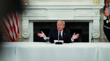 Donald Trump talks about taking daily doses of hydroxychloroquine pills in the State Dining Room at the White House in Washington