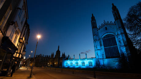 King's College at Cambridge University is bathed in blue light to salute local heroes during Thursday's nationwide Clap for Carers NHS initiative to applaud NHS workers fighting the coronavirus pandemic