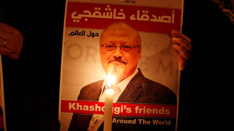 FILE PHOTO: A demonstrator holds a poster with a picture of slain journalist Jamal Khashoggi outside the Saudi consulate in Istanbul, Turkey.